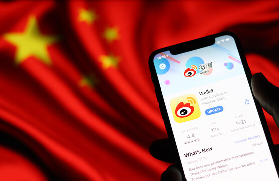 Weibo application on mobile phone screen on Chinese flag background : Chiang Mai, Thailand July 18, 2021