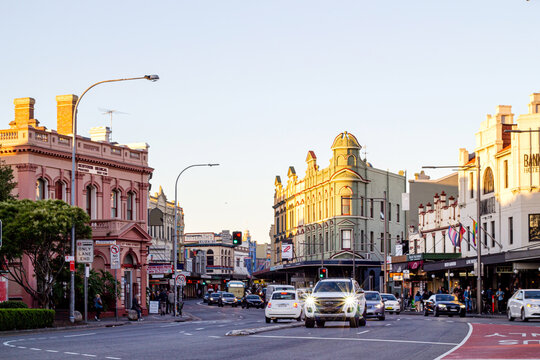 Horizontal shot of Newtown's street with buildings and cars