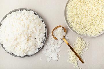 Fototapeta Flatlay with organic white soy wax, bee wax flakes. Handmade candles, diy, hobby idea obraz