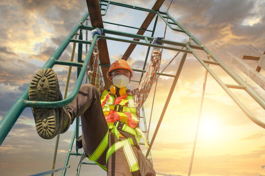 Construction worker wearing safety work at high uniform on scaff
