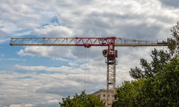 Construction crane on the construction site against the sky