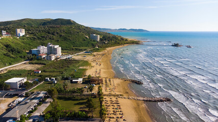 Sand beach aerial, top view of a beautiful sandy beach aerial shot with the waves rolling into the...