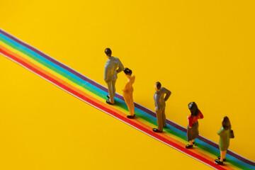 Fototapeta Group of figures of people stands on rainbow strip obraz