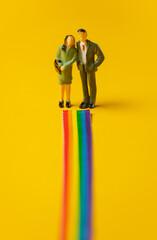 Fototapeta Woman and man stands face on rainbow path obraz