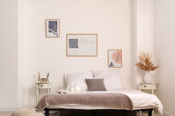Fototapeta Interior of stylish bedroom with pictures obraz
