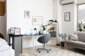 Fototapeta Interior of stylish room with modern workplace obraz