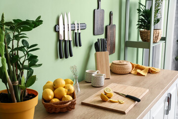 Set of knives and lemons on counter in kitchen