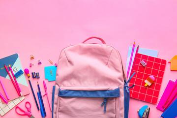 Fototapeta School backpack and stationery on color background obraz