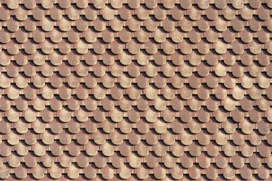 background of scalloped red clay roofing tiles