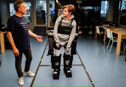 Robot exoskeleton helps wheelchair-bound get up and walk