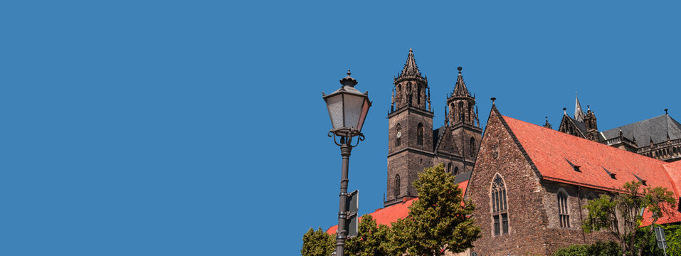 Banner with Cathedral of Magdeburg at dark blue sky solid background with copy space, Magdeburg, Germany. Concept of historical architecture heritage.