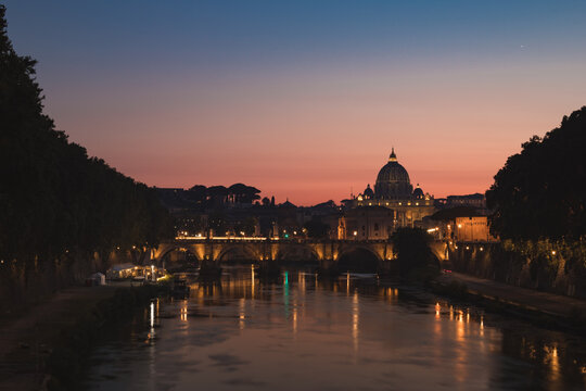 Sunset view of Vatican city and saint peter's basilica over angelo bridge