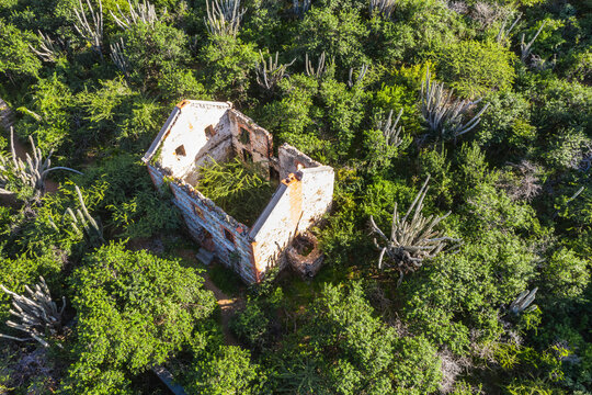 Aerial view above scenery of Curacao, the Caribbean with old ruins in mountains