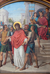 VIENNA, AUSTIRA - JUNI 17, 2021: The painting of Fall of Jesus before Pilate as part of Cross way stations in church Marienkirche by redemptorist Maximilian Schmalzl from end of 19. cent.