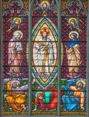 VIENNA, AUSTIRA - JUNI 24, 2021: The Transfiguration on the stained glass in the Votivkirche church originaly by workrooms from Austria (19. cent.).