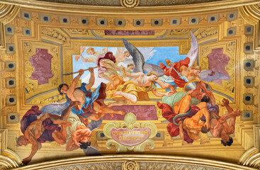 VIENNA, AUSTIRA - JULI 5, 2021: The fresco of St. Michaels war with Fallen angels in Jesuitenkirche - Jesuits church by jesuit Andrea Pozzo from begin of 18. cent.