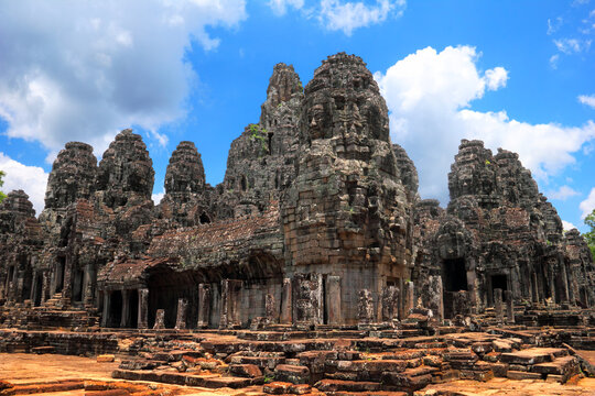 Beautiful scenic landscape with ancient Bayon temple (wide angle view) against the background of dramatic cloudy blue sky at day time, near Siem Reap, Cambodia, South East Asia