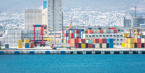 Obraz Warehouse and shipping container carriers at the port of Limassol, Cyprus  - fototapety do salonu
