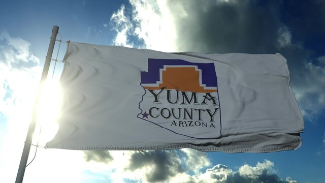 Yuma county flag, state of Arizona, United States of America waving at wind in blue sky. 3d rendering