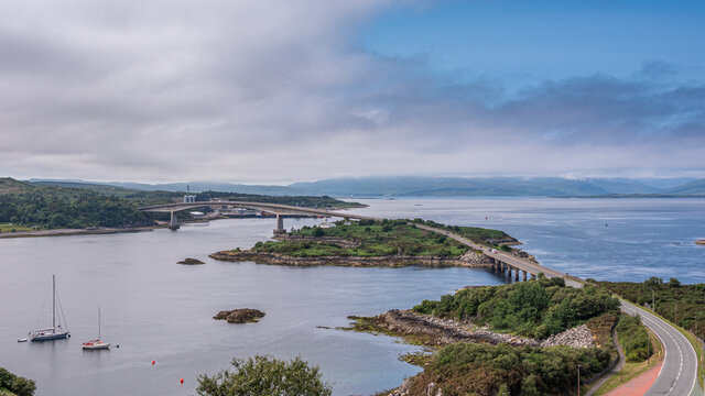 The Skye Bridge is a road bridge over Loch Alsh, Scotland, connecting the Isle of Skye to the island of Eilean Bàn and onto the mainland. Kyleakin Lighthouse can also be seen on the island