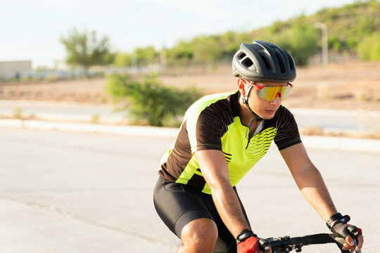 Handsome athlete exercising on a bicycle