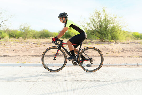 Sporty athlete riding a road bike outdoors