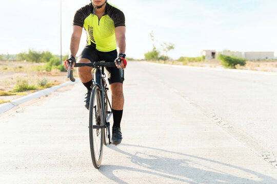 Focused cyclist pedaling his road bicycle