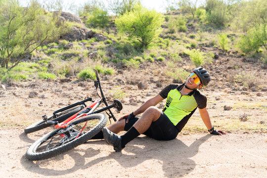 Hispanic athlete having an accident while training