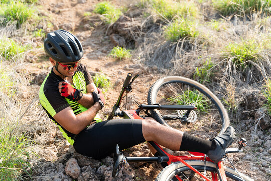 Latin athlete in pain after an injury outdoors