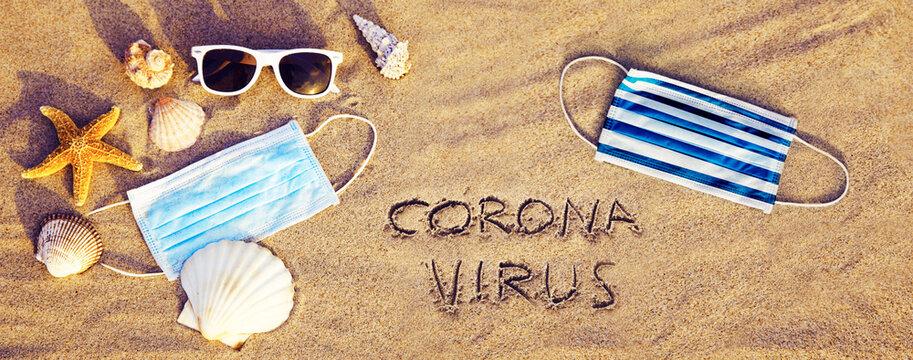 Corona virus decoration in the sand on vacation
