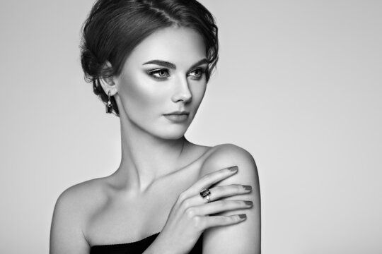 Portrait beautiful woman with jewelry. Model girl with manicure on nails. Beauty and Accessories. Black and white photo