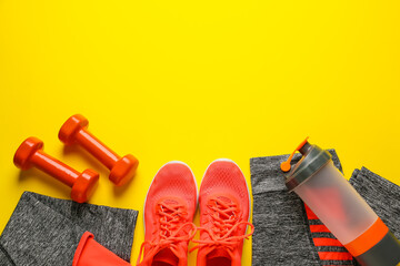 Fototapeta Sportswear and equipment on color background obraz