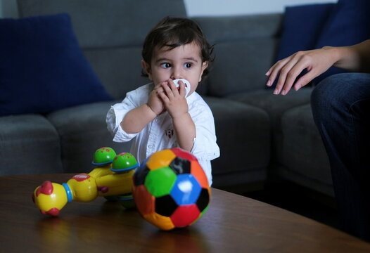 Baby George Khnaisser, whose mother was in labour at the moment of the last year's Beirut port blast is pictured at the family home in Jal el-Dib
