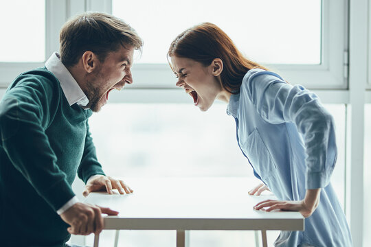emotional man and woman screaming at each other conflict