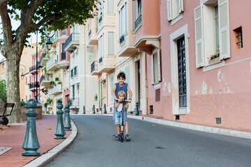Children, riding scooter in Monaco Ville