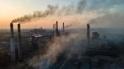 Fototapeta metallurgical plant heavy industry poor ecology top view smoke from chimneys smog obraz
