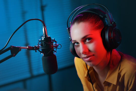 Charming radio host in the studio