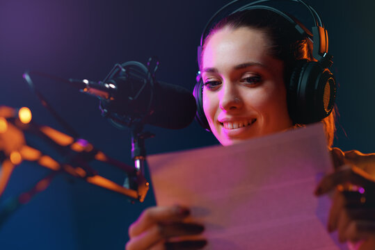 Young radio presenter broadcasting news
