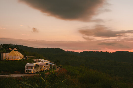 sunrise in morning with camping van on mountain
