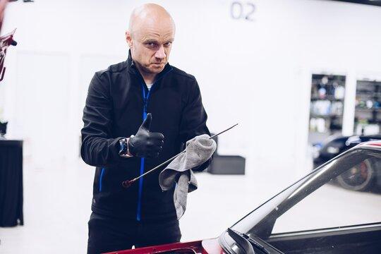 Man repairing car engine with his tools. Car service