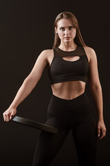 Fototapeta sportive girl holding iron disk obraz