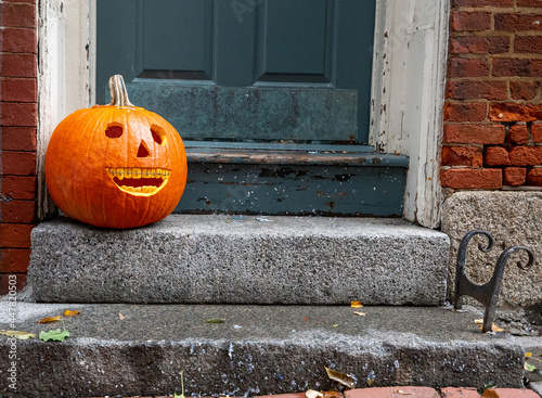 smiling pumpkin with braces. funny Halloween pumpkin on the doorstep. Orthodontic or dentist office. copy space for your text