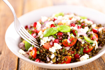 lentils salad with tomato,  feta cheese and basil