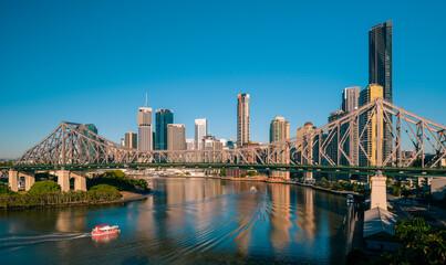 Fototapeta Brisbane city buildings, river and Story Bridge seen in early morning light. Brisbane is the state capital of Queensland, Australia. obraz