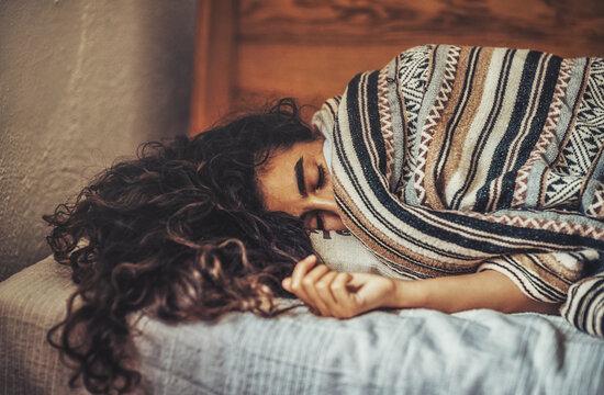 Beautiful sleeping woman in poncho.