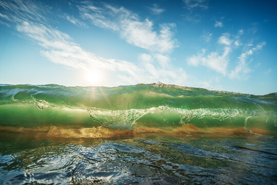 Beautiful green sunrise wave and sand on the beach