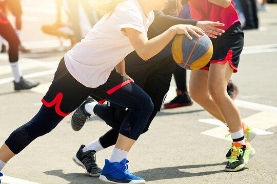Girls play street basketball