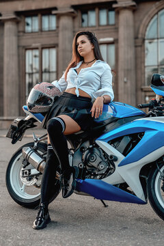 Shot of woman with motorbike in summertime outside