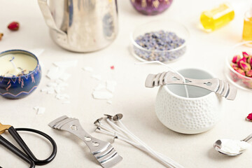 Fototapeta Ingredients and tools for handmade aroma candles. Organic soy wax, essential oils, wicks, pots obraz