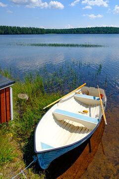 rowing boat at lake bredsjön in the swedish nature reserve hökensas